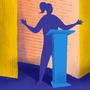 A woman stands in front of a large open book, behind a podium to tell her story.