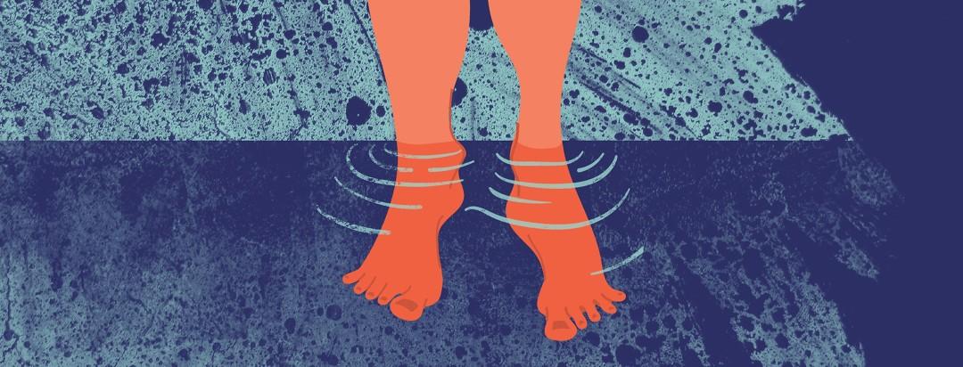 orange feet dangling in water