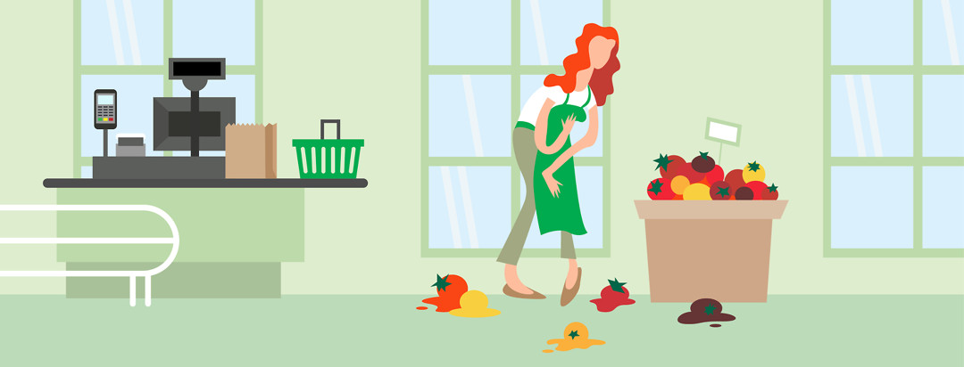 Grocer drops tomatoes and clutches her abdomen in pain while working.