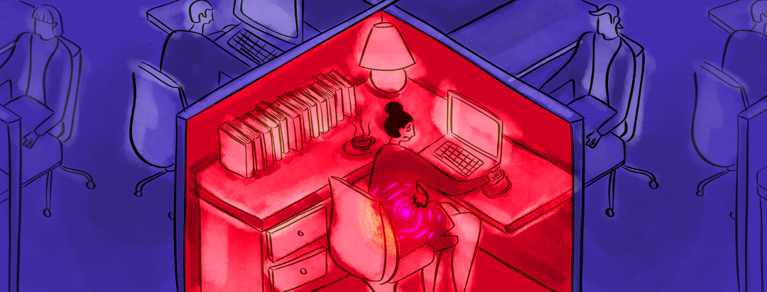 A scene of cubicles - in the centermost cubicle, a woman sits in front of her computer, clutching her stomach that has pain lines emanating from it.