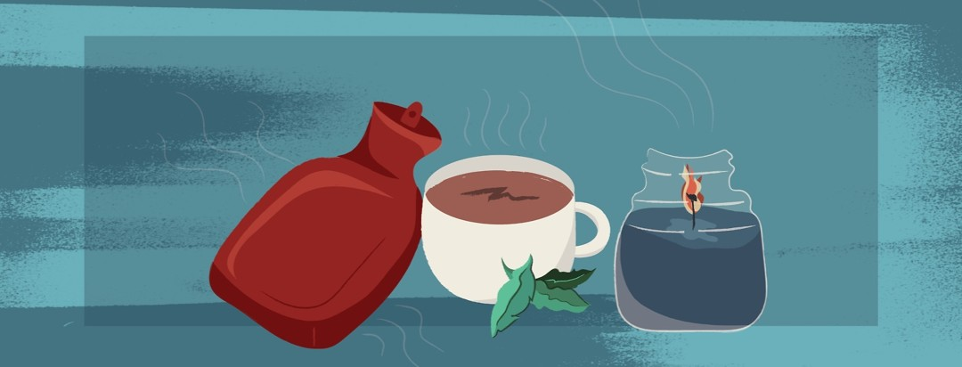 a hot water bottle, a cup of hot tea, mint leaves, and a burning candle