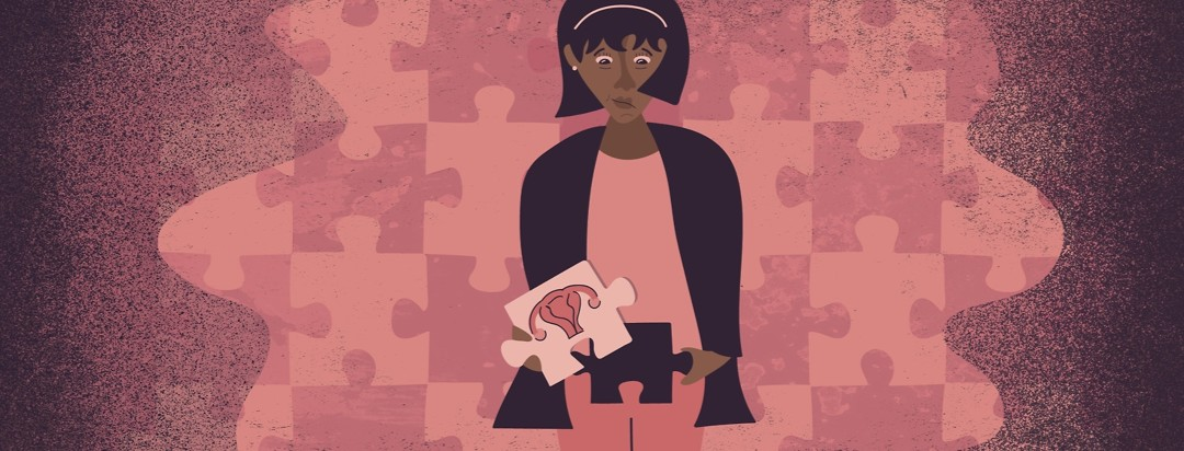 a woman holding a puzzle piece over her abdomen with a uterus on it
