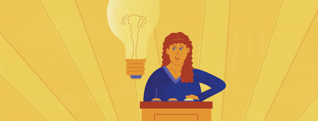 a woman at a game show podium hitting a buzzer with a lightbulb next to her head that has wires inside in the shape of a uterus