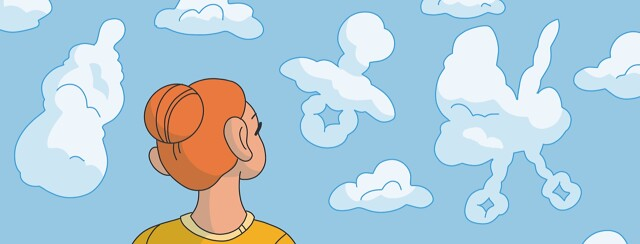A woman looks up at a sky with clouds shaped like baby items