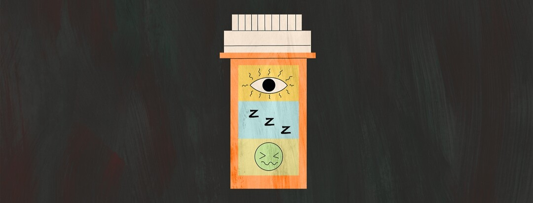 A pill bottle with side effects warnings on the label