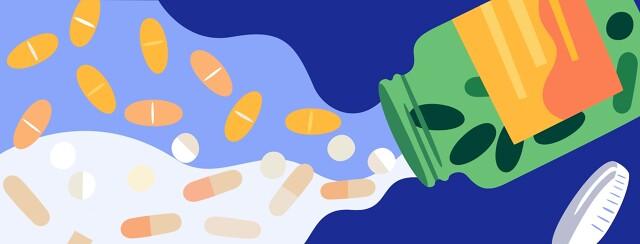 Open bottle of vitamins, pills