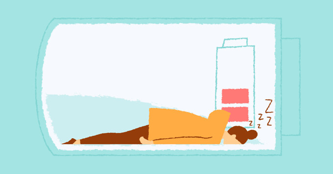 Woman lying face down inside empty battery