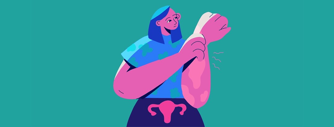 A woman with a uterus scratching her arm