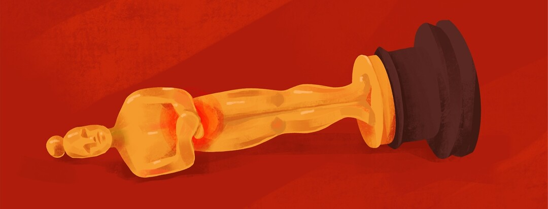 An oscar statue lies on its side with pain in its abdomen