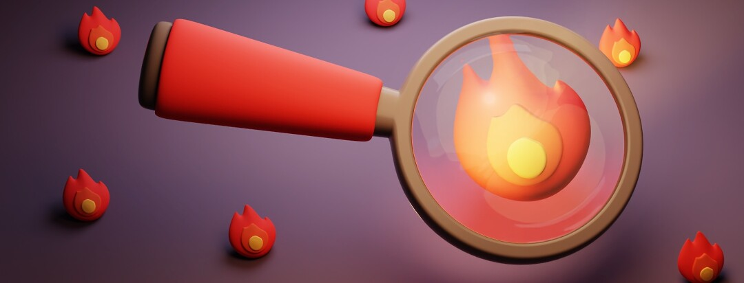 A magnifying glass inspecting a flame