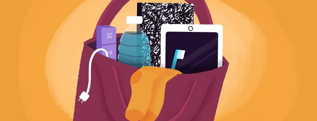 A tote bag with phone charger, ipad, medication, socks and toothbrush